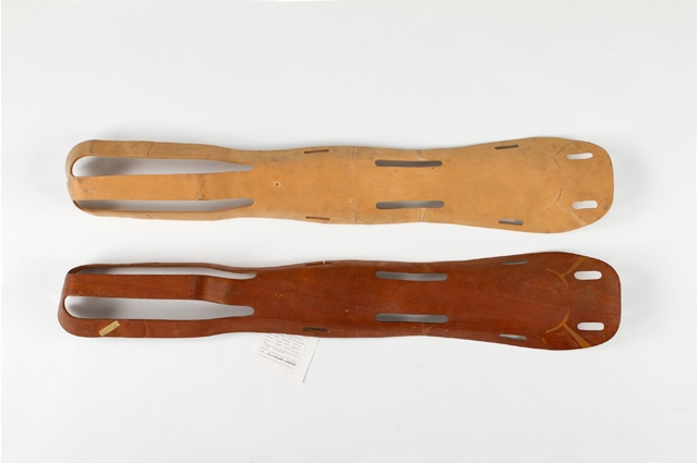 Two wooden leg splints, one light brown and the other dark brown