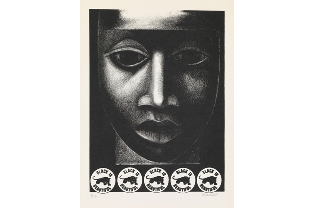 Black and white image of a woman's face with five stickers at the bottom that read: BLACK IS BEAUTIFUL