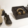 Adidas shoes, headphones, and other fashion objects on display in RESPECT