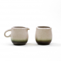 Creamer and open sugar stoneware with gradient glaze from dark green color at the base and fading upwards to stone color