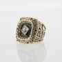 Green and gold championship ring