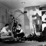 Black and white photo of Charles and Ray Eames sitting in their apartment