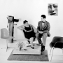 Black and white photo of Charles and Ray Eames sitting on a couch