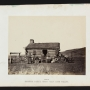 Mormon family gathers in front of their log house