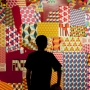 Silhouette of man in front of colorful geometric artwork