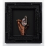 A photo collage image of a Black person on paper in custom mahogany and resin artist frame with automotive paint.