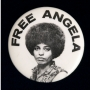 Black and white button of Angela Davis with text above her that reads: Free Angela
