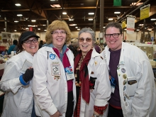 4 Oakland Women's Board members smile at the camera at the White Elephant Sale