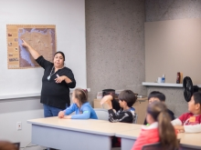 Corrina Gould, Native American Educator at OMCA, with a group of students, showing them original Ohlone territories in the Bay Area. Photo: Odell Hussey Photography