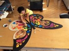 Bay Area artist Favianna Rodriguez painting Monarch Butterflies