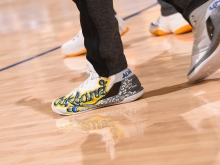 Steph Curry wearing Ghost Ship Fire tribute sneakers on the court. Photo by Noah Graham/NBA Photos