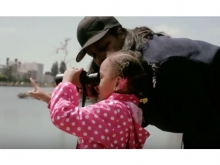 A young girl looks through binoculars