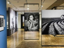 Installation shot inside Oakland Museum of California's exhibition of Dorothea Lange photography