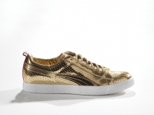 PUMA x Undefeated, Clyde Gametime Gold, 2012. PUMA Archives. Photo: Ron Wood. Courtesy American Federation of Arts/Bata Shoe Museum