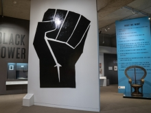 Black Power exhibition inside OMCA with a large black fist on the front wall, the words BLACK POWER on the left wall, and Black Panther 10 point program on the right wall