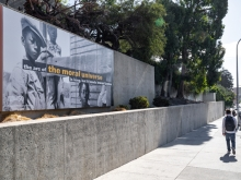 A billboard on the side of OMCA that reads: The arc of the moral universe is long, but it bends toward justice.