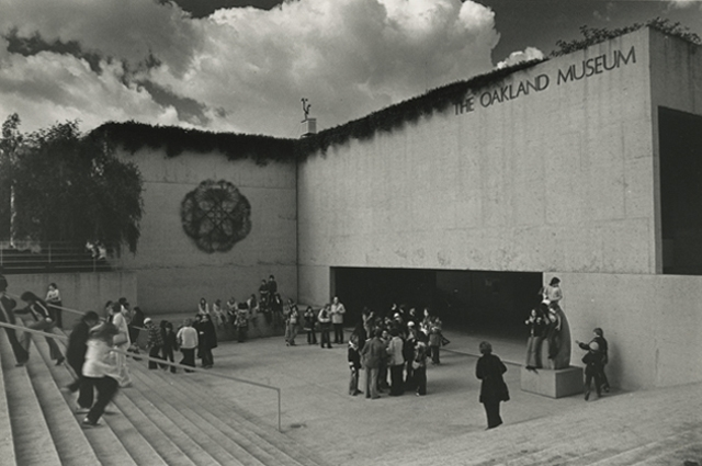Black and white archival image of the OMCA amphitheater filled with people
