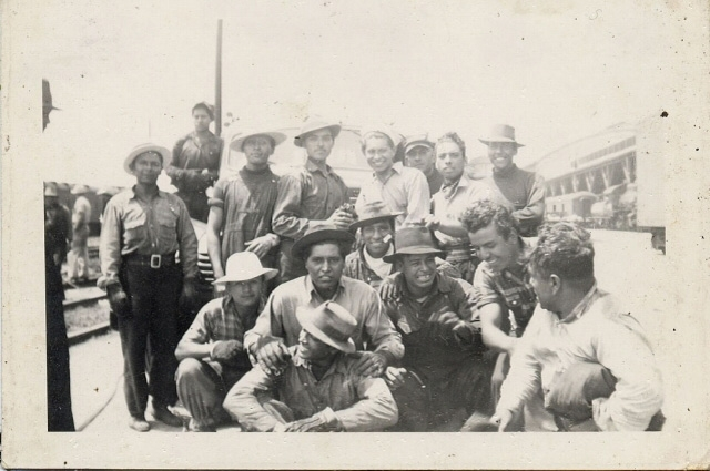 Black and white photograph of a large group of bracero workers
