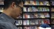 Cartoonist Gene Yang drawing in a comic book store. Courtesy of Articulate with Jim Cotter.