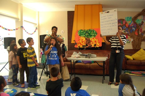 YMCA youth take turns singing to the audience.