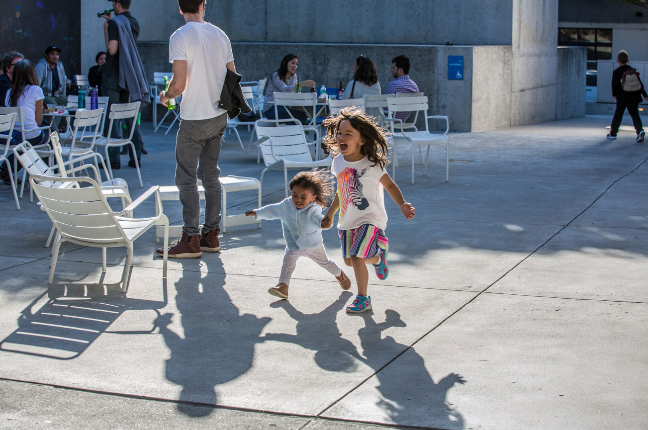 Two children running in the courtyard at the Oakland Museum of California
