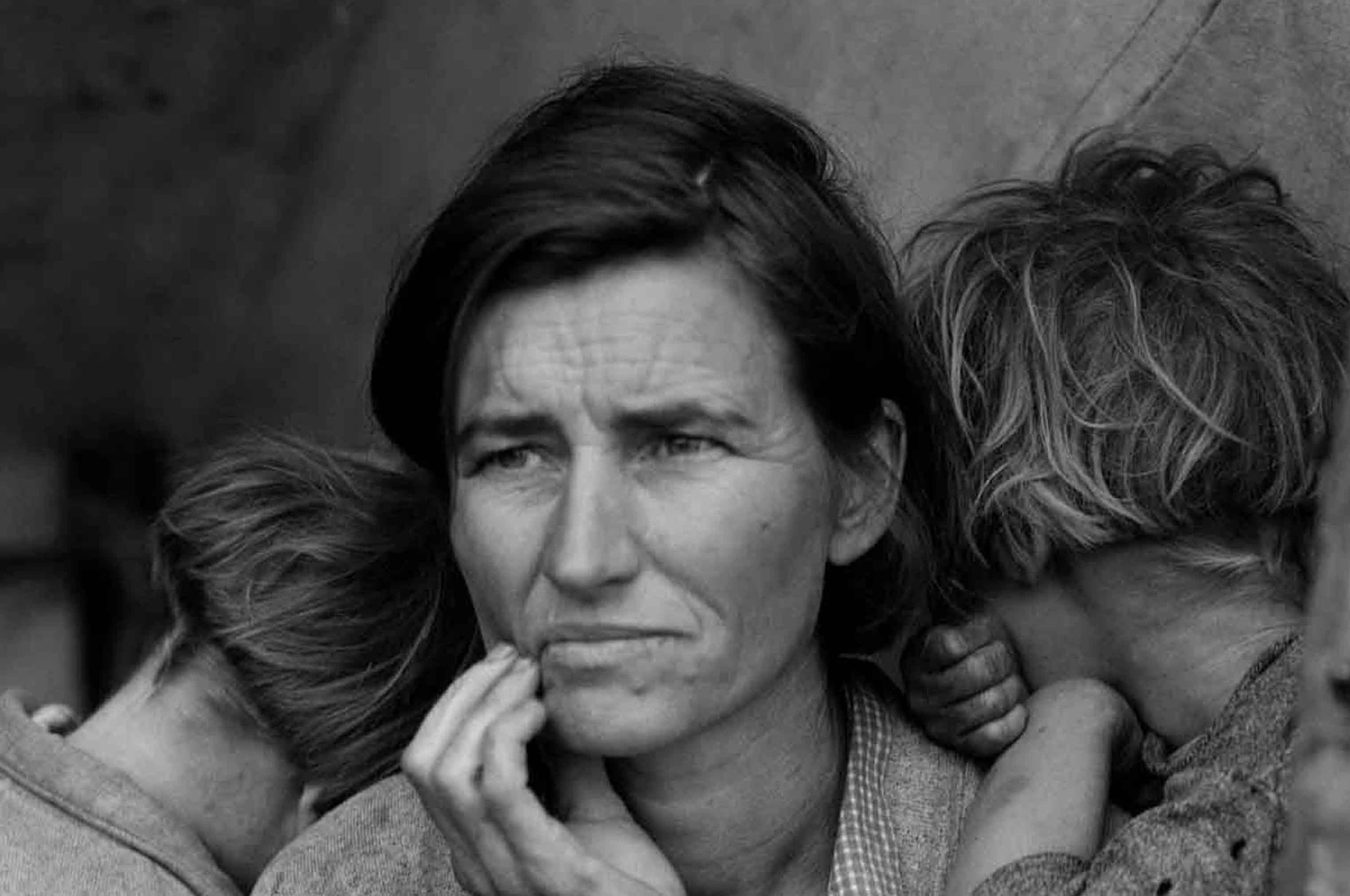 Woman looking pensive holding two children. Migrant Monther by Dorothea Lange, collection of the Oakland Museum of Caliofornia