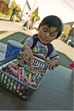 A young participant works with some art supplies.